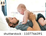 father playing with adorable... | Shutterstock . vector #1107766391
