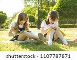 two little girl friends... | Shutterstock . vector #1107787871