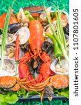 Small photo of Shellfish plate of crustacean seafood with fresh lobster as an ocean gourmet dinner