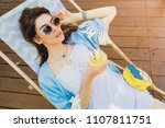 young attractive woman sitting... | Shutterstock . vector #1107811751