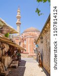 Small photo of Scenic alley and the historic Suleman Mosque in Rhodes Town, Mediterranean Sea, Greece, 06-02-2018 at 5pm