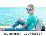caucasian little girl in a blue ... | Shutterstock . vector #1107865919