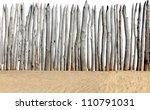 Old Wooden Fence On The Sand...