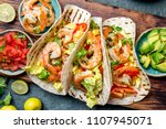 shrimps tacos with salsa ... | Shutterstock . vector #1107945071