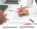 Stock photo proofreading paper on white table in office 1107979034