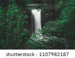 waterfall framed by green trees   Shutterstock . vector #1107982187
