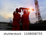 the oil workers in the job | Shutterstock . vector #1108008755