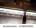 vase bottle flower brown wood... | Shutterstock . vector #1108063484