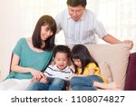 asian family having fun with... | Shutterstock . vector #1108074827