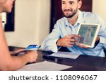 guest booking a tour at a hotel   Shutterstock . vector #1108096067