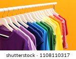 rack with rainbow clothes on... | Shutterstock . vector #1108110317