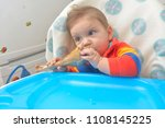 8 month baby  eating a turkey... | Shutterstock . vector #1108145225