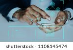 man typing on a smartphone | Shutterstock . vector #1108145474