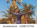 man enjoying tropical climate... | Shutterstock . vector #1108172744