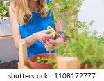 girl taking care of home grown... | Shutterstock . vector #1108172777