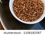 buckwheat in a white plate... | Shutterstock . vector #1108182587
