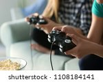 girls playing video games at... | Shutterstock . vector #1108184141