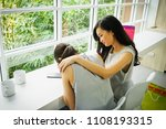 a beautiful woman soothes her... | Shutterstock . vector #1108193315