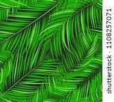 seamless pattern of palm leaves.... | Shutterstock .eps vector #1108257071