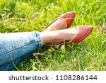 legs of a girl in jeans and red ... | Shutterstock . vector #1108286144