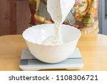 mixing dough with flour.   Shutterstock . vector #1108306721