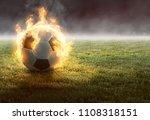 burning soccer ball on gras  3d ... | Shutterstock . vector #1108318151