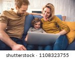 smiling family is browsing... | Shutterstock . vector #1108323755