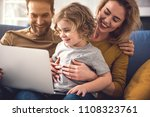 smiling mother is holding son... | Shutterstock . vector #1108323761