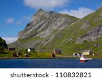 Picturesque village by the fjord on Lofoten islands in Norway - stock photo