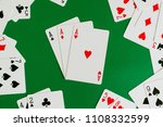 Small photo of three of a kind ace ,poker card in green background