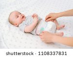 mother changes diapers to her... | Shutterstock . vector #1108337831