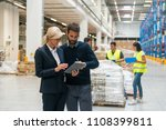 supervisors at warehouse | Shutterstock . vector #1108399811