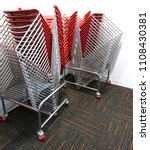 Small photo of Heavy duty chair trolleys allow quite a number of visitors' chairs to be stacked on them. They are low and small size which make them portable and moving them around is smooth and convenient.
