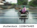 motorcycle raincoat in the rain ... | Shutterstock . vector #1108476485