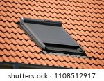 roof window with roller shutter | Shutterstock . vector #1108512917