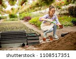 view at young woman working in... | Shutterstock . vector #1108517351