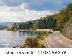 autumn road along the sea....   Shutterstock . vector #1108596359