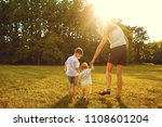 mother and children are walking ... | Shutterstock . vector #1108601204