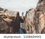 travel couple on kjeragbolten... | Shutterstock . vector #1108604441