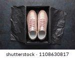 pair of pink sneakers in shoe... | Shutterstock . vector #1108630817