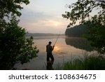 silhouette of fisherman... | Shutterstock . vector #1108634675