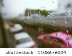 rain drops on car window with... | Shutterstock . vector #1108676024