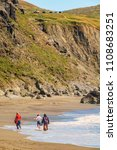 Small photo of SONOMA COUNTY, CA/USA - MAY 26, 2018: Three women wade through seawater in a rising tide along Goat Rock Beach, a popular destination for beachcombers and other sightseers in Sonoma Coast State Beach.