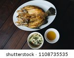 fried fish on white plate with... | Shutterstock . vector #1108735535