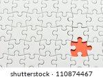Stock photo plain white jigsaw puzzle on orange background 110874467