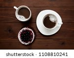 two cups of coffee and a berry... | Shutterstock . vector #1108810241