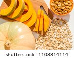 toasted pumpkin seeds with raw... | Shutterstock . vector #1108814114