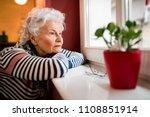 Sad Alone Senior Woman Looking...