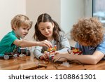 group of kids putting a kit... | Shutterstock . vector #1108861301