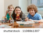 cheerful kids showing their... | Shutterstock . vector #1108861307